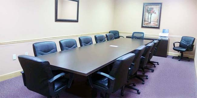 large conference room with chairs around conference table